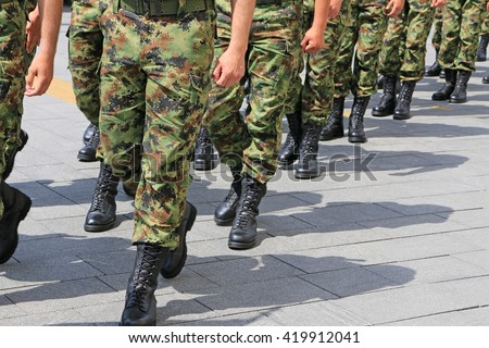 Military troop marching - stock photo
