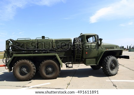 Military truck on the airfield in summer