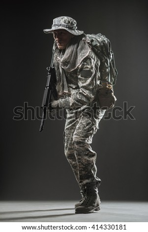 Military, war, conflict, soldiers - Special forces soldier man hold Machine gun on a  dark background. - stock photo