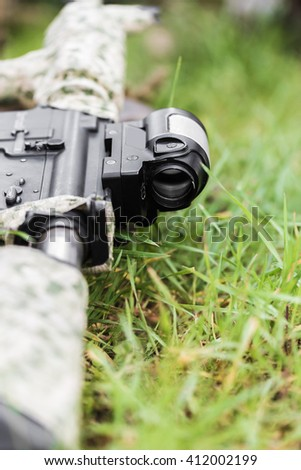 military weapon rifle close-up on green grass - stock photo