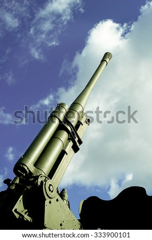 Military weapons antiaircraft gun against the sky