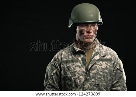 Military young man wearing helmet. Studio portrait. - stock photo