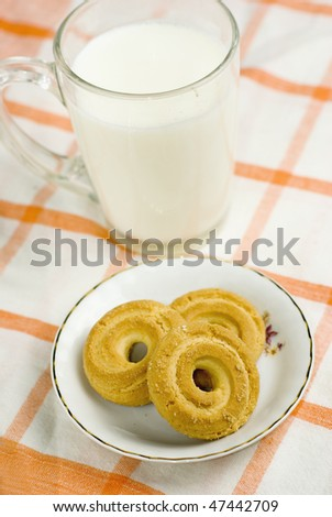 Milk and biscuit with selective focus - stock photo
