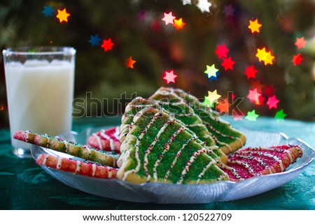 Milk and Christmas Tree Cookies with Bokeh from Xmas lights - stock photo