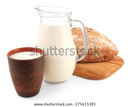 Milk and loaf of bread isolated on white