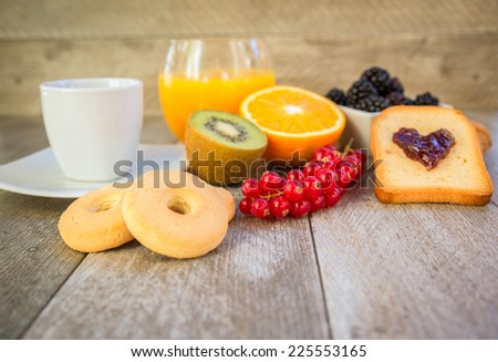 Milk and muesli with berries - Healthy breakfast with fresh natural ingredients - Close up on breakfast table - stock photo