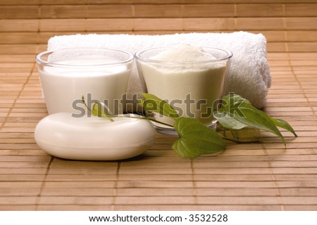 milk bath items. soap, milk, towel. white therapy