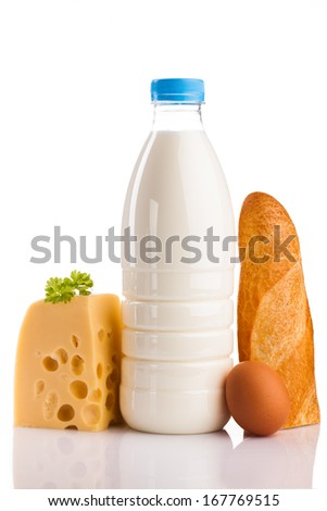 milk bottle cheese bread and egg isolated on white - stock photo