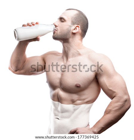 milk bottle in the hands of a sports person, healthy man with the proper way of life