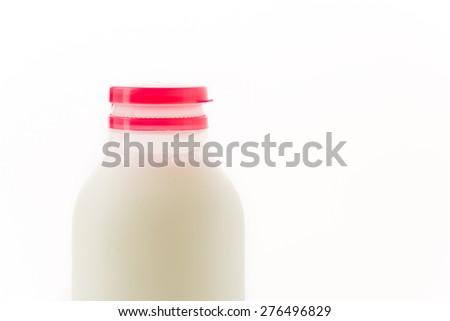 milk bottle on white background - stock photo