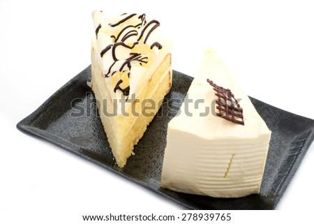 Milk cake and white chocolate cake - stock photo