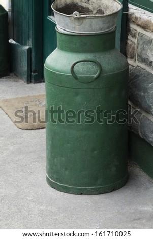 Milk canister near the door of a restaurant, Killarney, County Kerry, Republic of Ireland - stock photo