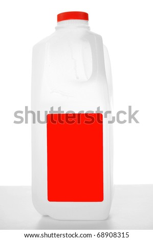 milk carton with red label on a shiny table with white background. 1 Liter. - stock photo