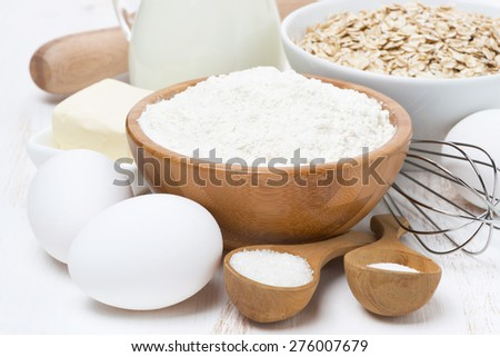 milk, cereal and ingredients for baking on wooden table, close-up - stock photo