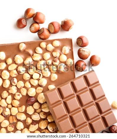 Milk chocolate bars with hazelnuts isolated on white - stock photo
