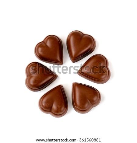 Milk chocolate heart shaped pralines arranged in circle. - stock photo