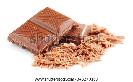 Milk chocolate pieces isolated on white - stock photo