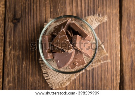 Milk Chocolate (selective focus) on wooden background (close-up shot) - stock photo
