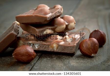 milk chocolate with hazelnuts - stock photo