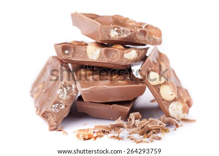 Milk chocolate with hazelnuts on white background - stock photo