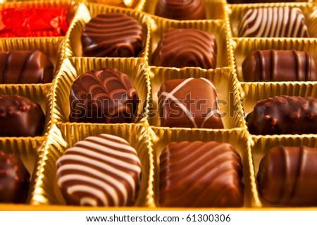 Milk chocolates candies in a box - stock photo