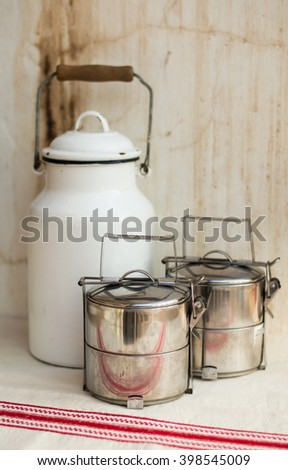 Milk churn and metal boxes