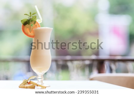 Milk cocktail with orange and carom - stock photo