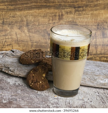 milk coffee in glass and cookies