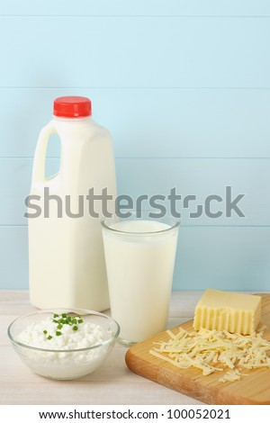 Milk, cottage cheese and shredded swiss cheese are healthy sources of protein and food allergens - stock photo