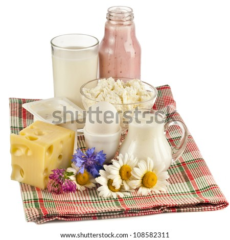 milk dairy products with daisy isolated on white background