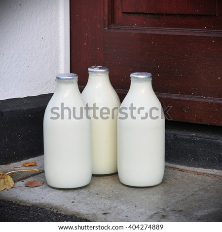 Milk Delivery outside a House Front Door - stock photo