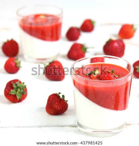 Milk dessert - panna cotta with strawberry sauce and strawberries - stock photo