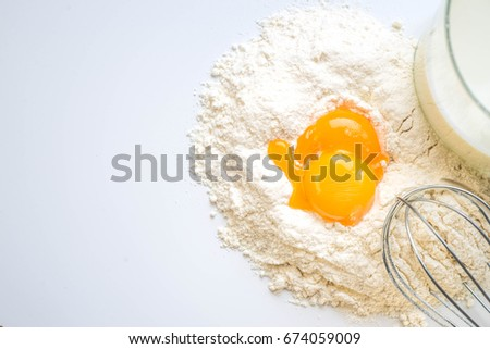 Milk eggs and flour on a white background