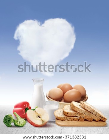 Milk, eggs, bread, apples, vegetables, wood floors on the ground after the clouds heart healthy. - stock photo