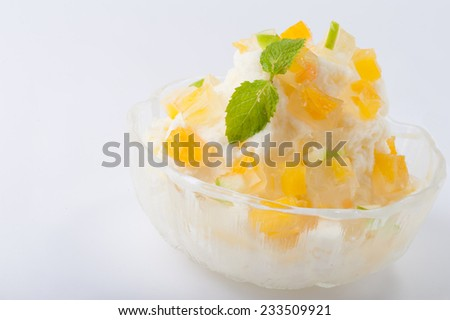 Milk flavoured shave ice with mango jelly - stock photo