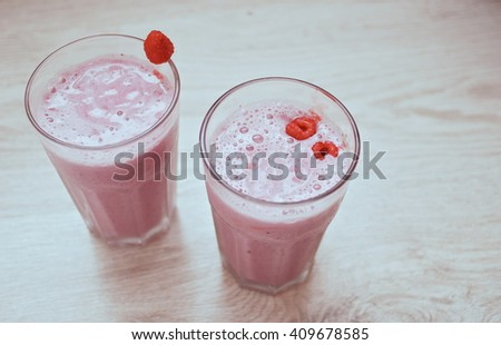 Milk fruit cocktail with fresh raspberries