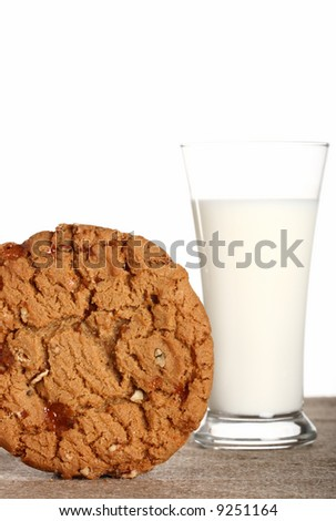 milk glass with toffee pecan cookie on burlap canvas, Shallow dof. - stock photo