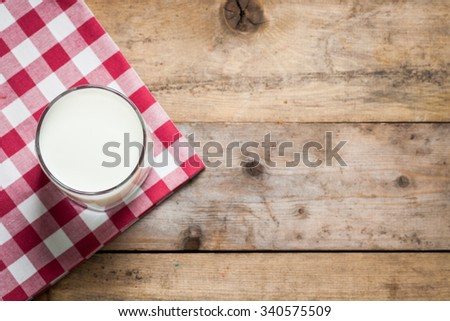 Milk in a glass on a wooden table top view - stock photo
