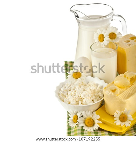 Milk in a glass on the tablecloth,  border, isolated on white background - stock photo