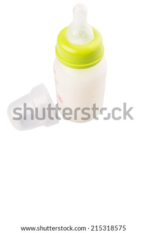 Milk in baby bottle over white background - stock photo