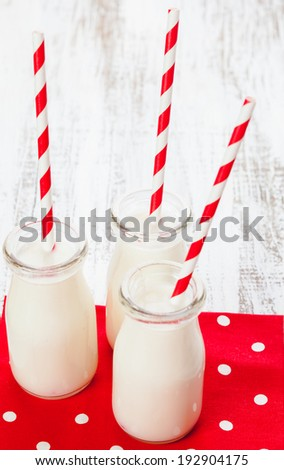 Milk in bottles with paper straws for children