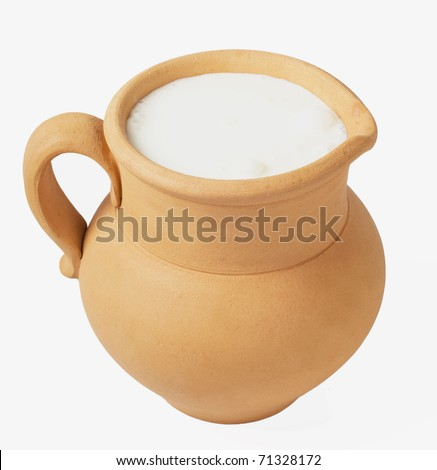 Milk in clay jug on  white background - stock photo