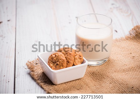 milk in glass with cookies on stack - stock photo