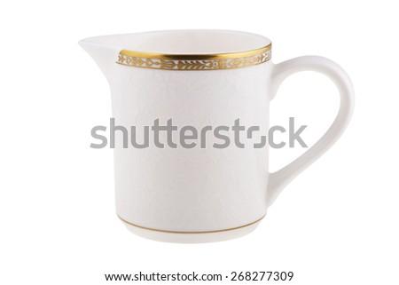 Milk jug isolated on white. - stock photo