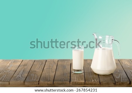 Milk. Milk and sunny spring field - stock photo