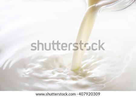 Milk, pour - stock photo