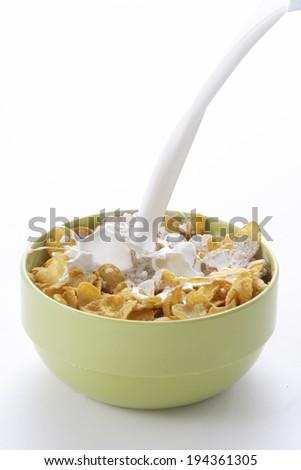 Milk pour on corn flakes - stock photo