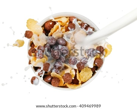 Milk pouring over a cereal breakfast, top view - stock photo