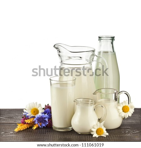 Milk produce in a glass on the wooden table isolated on white background - stock photo