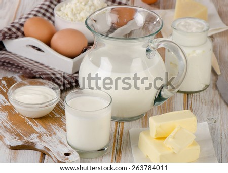 Milk products on a wooden table. Selective focus - stock photo